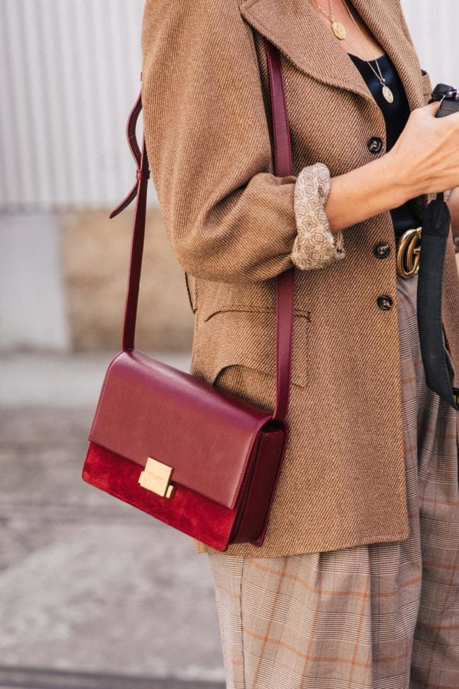 long brown coat with lighter brown pants, and, for the colour, a cherry red bag